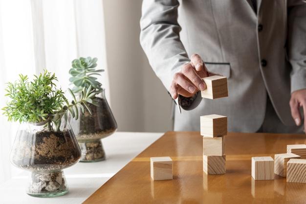 man-building-pile-wooden-boxes_23-2148301728